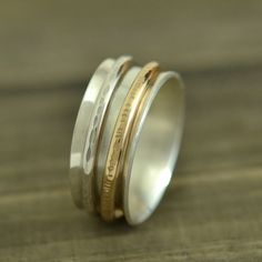 Spinner Ring -smooth band adorned with two spinning bands.
