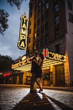 Outdoor, Nighttime Downtown Tampa Engagement Photography Session at Tampa Theatre| Marc Edwards Photographs