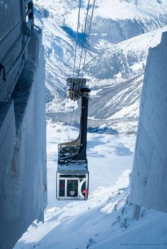 The Aiguille du Midi cable car approaching its top station 3842m above Chamonix, French Alps.