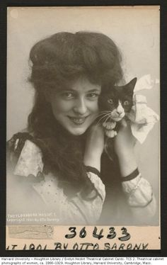 "American Gilded Age and beyond - show girl, dancer, and artist model, Evelyn Nesbit, (1884-1967).  A posed theatrial cabinet card view c.1901, of Nesbit holding a cat. The cat was, ""The Florodora - (dance troupe) Mascot"". Photograph taken at: Otto Sarony Studio, NYC. ~ {cwlyons} ~ (Original Image:  Harvard University)"