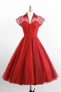 Sheer tulle shirtdress over a red sweetheart-necked lining.  1950s .