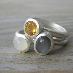I love Etsy.com Raised and tapered bezels support this gorgeous suite of Moonstone and Citrine. Black Moonstone and white moonstone cabochons measuring 8mm x 6mm and 6mm are set in these heavy Argentium sterling settings, as well as a blazing 6mm citrine.