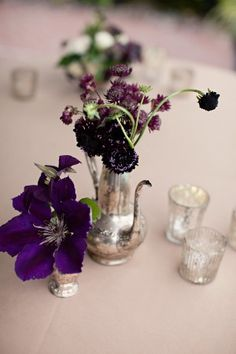 love the mix of mercury glass, silver and purples.