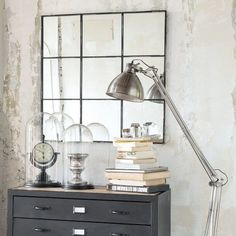 TOBIAS metal mirror in black H 90cm Ref. 138494  Dimensions (cm) : H 90 x W 90 x DE 3 Weight: 13 Kg  With its quadrilateral effect, this metal mirror will give relief to your living room. Formed by black metal baguettes, this modern mirror will enlarge you room, whilst remaining sober and discreet. To be fastened to the wall or placed on a unit, this black mirror will fit particularly well into an industrial or contemporary ambience.