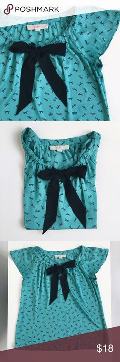 LOFT top. LOFT short sleeved top with black draw string bow.                 No stains. LOFT Tops
