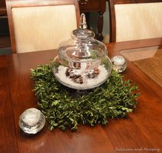Artificial snow, glass icicles, pine cones and a boxwood wreath.