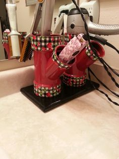 PVC, spray paint, and duck tape. ... custom hair tool holder