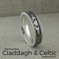 Celtic Claddagh Wedding Ring 5.2 mm Wide Sterling Silver  with Oxidized Background and Polished Design Design features two Claddaghs with Celtic Knot between them.