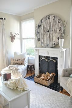 """Absolutely LOVE the clock over the mantle and the long """"Our Nest"""" pillow on the love seat. (in one of the pics not shown here)."""