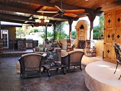 Posted by RMSer Keith Munyan, this gorgeous covered patio features a barbecue area, fountain and firepit.