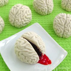 """<strong>Get the <a href=""""http://www.hungryhappenings.com/2012/10/creepy-halloween-sweets-cake-ball.html"""" target=""""_blank"""">Cake Ball Brains Oozing Cherry Blood recipe</a> from Hungry Happenings</strong>"""
