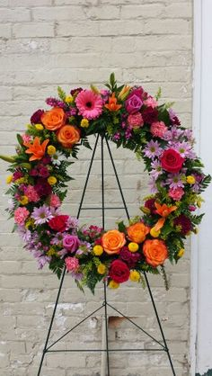 Colorful wreath by flowers on main