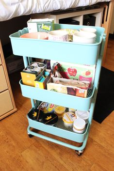 My Dorm Tour - The Blogging Brew - I used this Raskog cart from IKEA to make a super cute pantry! It slides right under the bed, and fit just about everything I need!