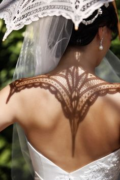 (Photo by Jerry Ghionis) I love the shadow! Maybe a veil idea too.