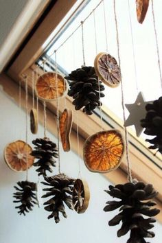 dried orange slices, several pine cones and star shapes, tied to a string and hanging from a ceiling window with wooden window pane Christmas decorations ▷ 1001 + Ideas for DIY Christmas Gifts and Festive Decoration Noel Christmas, Diy Christmas Gifts, Holiday Crafts, Christmas Ornaments, Natural Christmas Decorations, Autumn Decorations, Homemade Christmas, Christmas Ceiling Decorations, Orange Decorations
