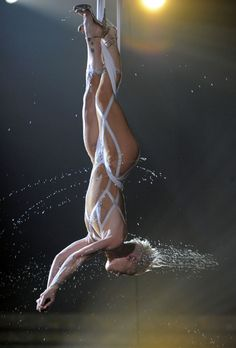 "Pink does a now-famous high-wire performance of ""Glitter In The Air"" drenched in water at the 52nd GRAMMY Awards in 2010"