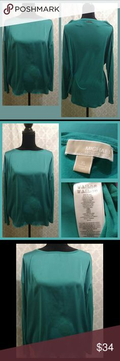 NWOT. Michael Kors Teal Blouse. New without tags. I purchased and washed, but it didn't fit me right so I never wore it. My loss is your gain.   It's a beautiful teal color. High- low style ( shorter front, longer back). Perfect with leggings or skinny jeans/pants. The front is a silky panel of fabric and the back is more cotton-like. Michael Kors Tops Blouses