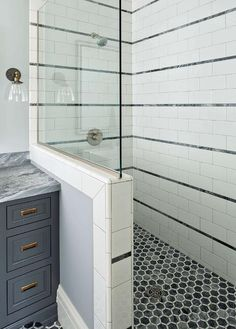 Bathroom Subway Tile Accent white subway tiles frame a gray marble herringbone tiled shower