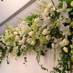Garden inspired stage backdrop with lilies, hydrangeas, ranunculus, and white orchids