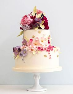 21 Two-Tiered Cakes That Prove Bigger Isn't Always Better - floral decorated two tired white wedding cake