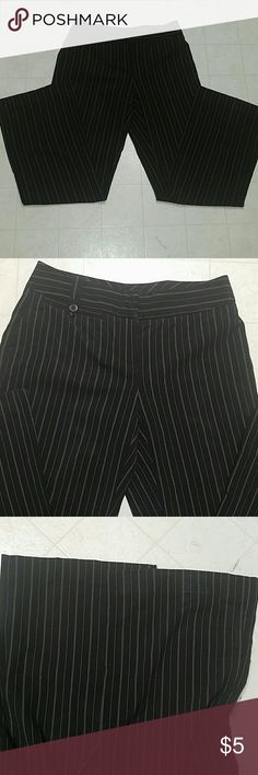 Black pinstripe dress pants Black pinstripe dress pants made by Emma James in size 4 petite. Material is 62% polyester 33% rayon 5% spandex. These have stretch. One pocket in the front 1 pocket on the back. The Pinstripe is a pink and a white stripe. inseam is 28 inches. Bootcut bottom and a low-rise waist Emma James Pants Trousers