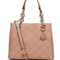 Michael Kors limited edition rose gold purse 100% authentic Michael Kors light pink purse with rose gold hardware. Comes with dust bag. Bought it around Xmas but I'm upgrading to a Lady Dior Michael Kors Bags Crossbody Bags