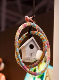 Birdhouse made with embroidery hoops and ribbons