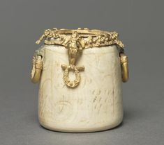 Cosmetic Jar, 500-550      Byzantium, probably Syria, early Byzantine period, 6th century      ivory and gold, Overall - h:4.80 w:4.00 cm (h:1 7/8 w:1 9/16 inches).