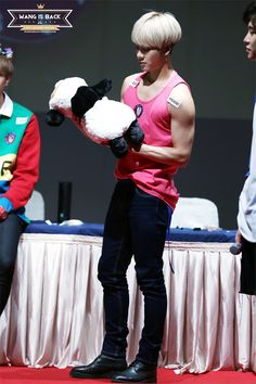 This is just so wrong. White bobbed hair, pink sando, and a stuffed panda but still manly. I think I'm blinded