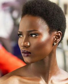 Nigerian Olufunke Williams. Dark purple lipstick on dark skin (clear brunette complexion) @funke_williams
