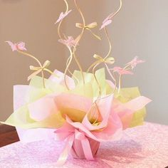 Table Centerpiece. It doesn't have to be butterflies and bows, but I like that it's simple and colorful.