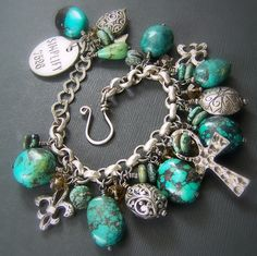 Chunky Charm Bracelet in Nevada Turquoise, Sterling Silver, Smokey Quartz & Pewter Handmade by Willow Creek Jewelry on Etsy    Handmade  bursting with gorgeous genuine Nevada turquoise, oxidized silver, pewter and faceted smokey quartz; all anchored by a wonderfuly oxidized silver Rolo chain.