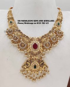 Gorgeous gold necklace with rice pearl hangings. Necklace with lakshmi devi motifs. Necklace studded with multi precious stones. Bridal Jewelry, Beaded Jewelry, Beaded Necklace, Gold Necklace, Emerald Necklace, Necklaces, Collar Necklace, Indian Gold Jewellery Design, Indian Jewelry Sets