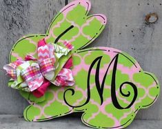This fun decorative bunny door hanger is the perfect accent for any room or door to celebrate Easter and the Spring Season  The design is a combo of classic chevron and small dots. Colors are a combo of pinks , lavenders and mint green which is painted with high quality acrylics and sealed for protection.  The bow is multi patterned and fabrics. Combinations might vary due to availability.  Any saying or monogram can be added just put into the notes all specifications.  Colors and patterns…