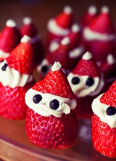 Santa strawberries! Use whipped cream or cream cheese for the beard and chocolate chips for the eyes. Cute and tasty! Ho, Ho, Ho!