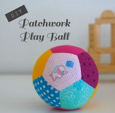 These patchwork play balls are great handmade baby gifts. They're bright and colorful and make a nice rattling sound when you roll them back and forth. This project is made with English Paper Pieci... whileshenaps.com