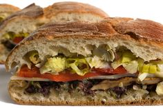 Vegetarian Muffuletta - just take out the mushies and it would be a perfect fit for some homemade ciabatta!