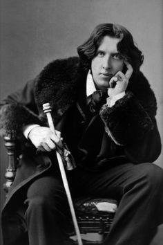 Oscar Wilde, author of The Picture of Dorian Gray.  Read a review at http://readinginthegarden.blogspot.com/2013/02/the-picture-of-dorian-gray-by-oscar.html
