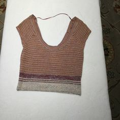 Free people sweater Cute little free people boho style sweater. Size med scoop neck and back style . Earthy colors perfect with a flare Jean . Size med Free People Sweaters