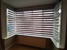 Day and Night roller blinds fitted into bay window in living room in Sidcup, London I Made to measure blinds Blinds For Bay Windows, Blinds For Windows Living Rooms, Bay Window Living Room, Day Night Blinds, Blinds Inspiration, Night Window, Bungalow Ideas, Made To Measure Blinds, Houses
