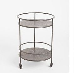 """It's simple and sleek. Combine this modern side table with a vintage lamp to make a room or find a funky flower pot to put some great greenery on the bottom. * Iron  * Wipe clean  * Imported  * Some easy assembly required  * 17"""" diameter, 24""""h — Wicki Mitchell 199"""