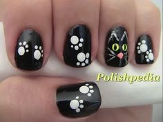 Halloween Black Cat Nails  The more simple the nail art is it seems to be that much better so I made sure to keep this one really simple. The only tools you will need is a nail dotting tool, a nail striper (I used a kiss nail art brush), and a short flat nail art brush for the eyes. You will also need a black, white, neon yellow, and a silver.