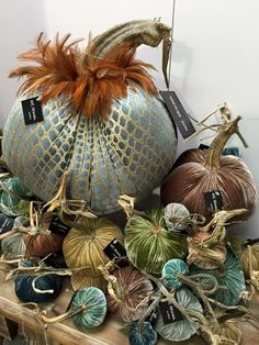 That blue pumpkin with the gold patten and those feathers is so pretty! Well they all look nice but I need to have that big one ; Velvet Pumpkins, Fabric Pumpkins, Sweater Pumpkins, Fall Pumpkins, Fall Halloween, Halloween Crafts, Thanksgiving Decorations, Halloween Decorations, Autumn Crafts