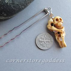 Hangin Out Harry    Harry is made of bone... as any good skeleton should be. He is wire wrapped to a long silver-plated hair pin and is the perfect accessory to add a little season fun to your hair.    He is wire-wrapped with sterling silver, set off with sterling rounds and a Swarovski crystal.
