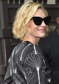 Glamorous: The 47-year-old looked effortlessly elegant in the monochrome outfit, which fea...