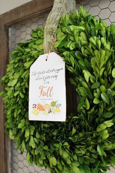 Use iron-on transfer paper to place art on a sturdy piece of fabric, like canvas. Then tie the tag to a vibrant boxwood wreath for sophisticated door decor.