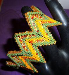 bracciale geometrico toni arancio e verde di Carlacollanebijoux