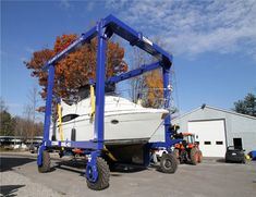 25 ton travel lift is a portable traveling boat hoist, it can used for lifting and moving boats efficiently and safely. Boat Hoist, Gantry Crane, Emergency Power, Marine Boat, Small Boats, Electric, Traveling, Remote, Construction