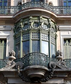 Pretty detailing on these windows/ balcony