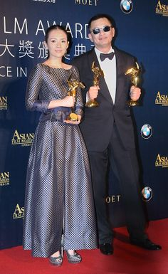 Chinese actress Zhang Ziyi and Hong Kong director Wong Kar-Wai pose with their trophies for Best Actress and Director awards respectively for their movie 'The Grandmaster' at 8th Asian Film Awards ceremony in Macau, China, March 27, 2014.